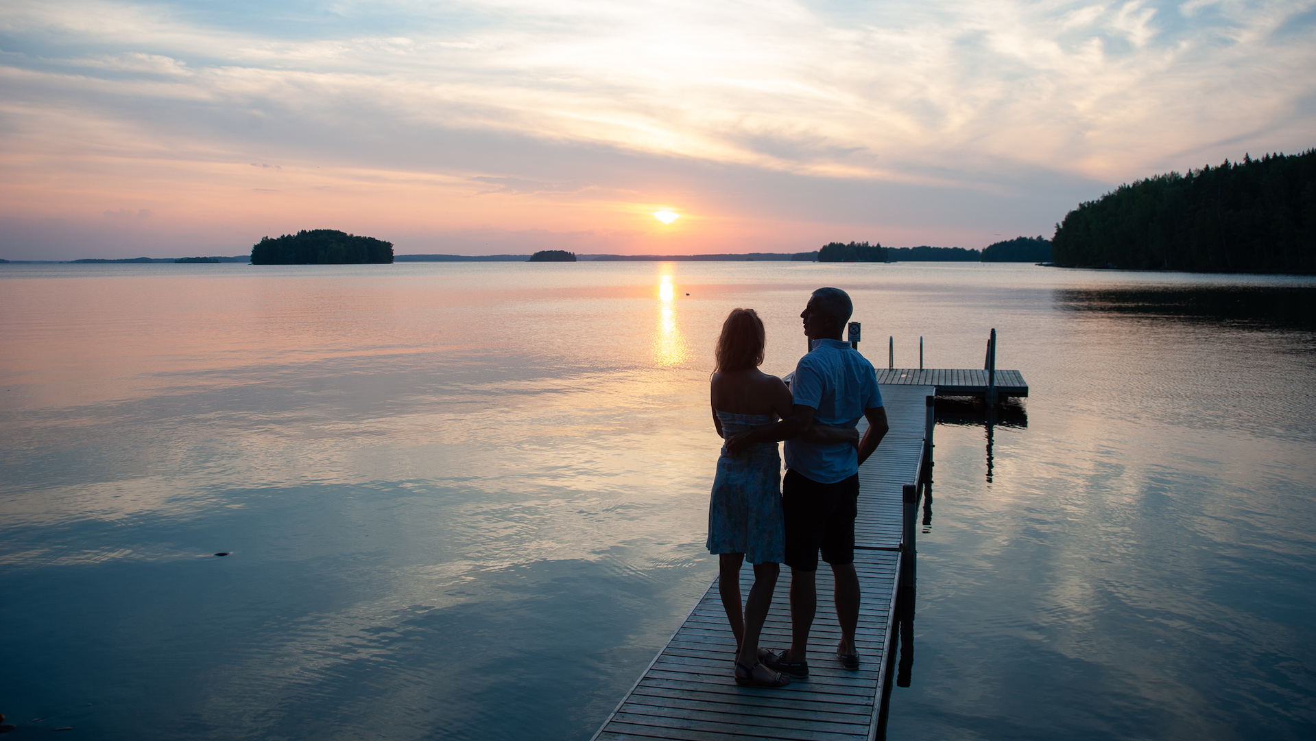 Romantic couple by lake Vanajavesi in Finnish Lakeland